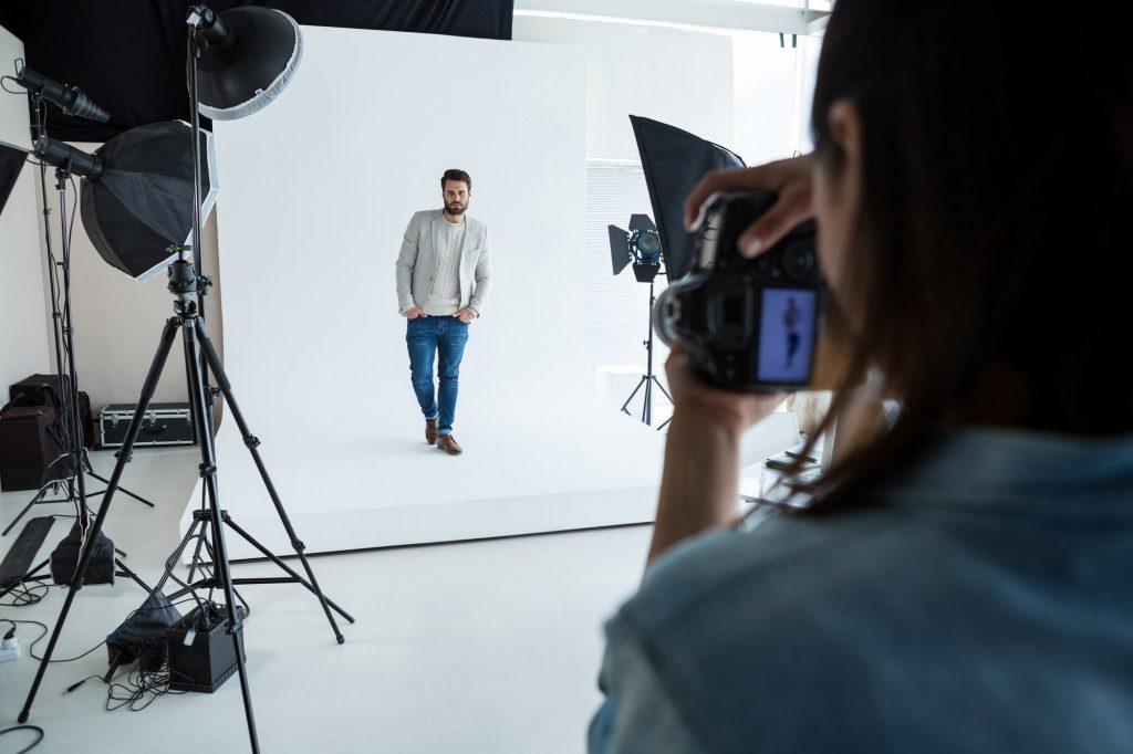 Male model posing for photographer